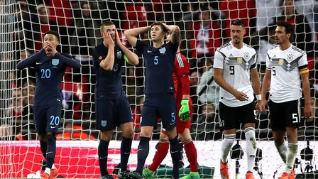 England's Jesse Lingard (left), Eric Dier and John Stones (centre) react after a missed chance durin