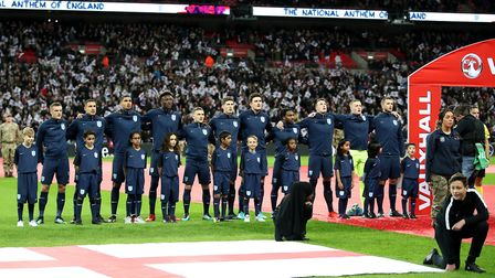England players sing the national anthem prior to the International Friendly match at Wembley Stadiu