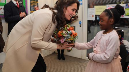 The Duchess of Cambridge receives flowers from six-year-old Nevaeh during her visit to Hornsey Road