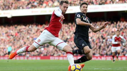 Arsenal's Aaron Ramsey and Swansea City's Federico Fernandez battle for the ball during the Premier