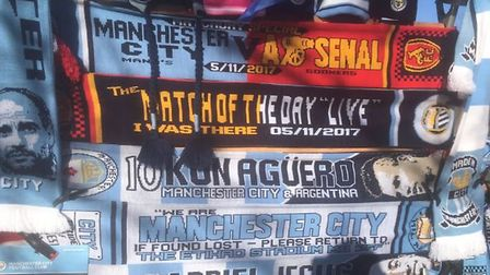 The dreaded 'half and half' scarf makes an appearance at Manchester City before kick-off against Ars