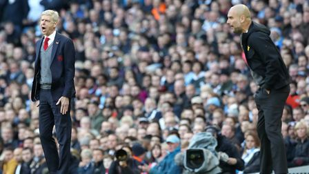 Arsenal manager Arsene Wenger (left) and Manchester City manager Pep Guardiola during the Premier Le
