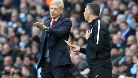 Arsenal manager Arsene Wenger (left) speaks to the fourth official during the Premier League match a