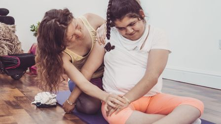 Yoga practitioner Denisa with Tyler, 17, demonstrating a yoga technique to the panel during the appl