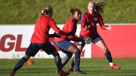 Arsenal's Danielle Carter (centre) in England training at St George's Park (pic Joe Giddens/PA)