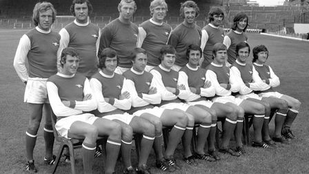 The Arsenal football team pose for a group picture at Highbury stadium, in London, ahead of the 1971