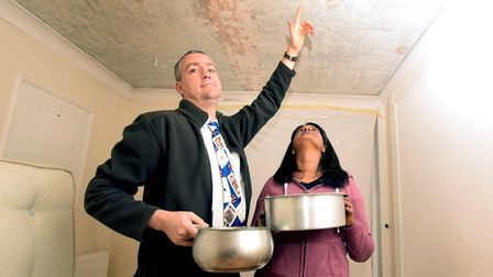Stephen and Melanie Thorne catch the drips from their leaking ceiling. Picture: Polly Hancock