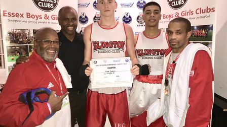 Islington youngsters Ewan Jenkins and Bob Miah with John Richards, former world champion Colin McMil