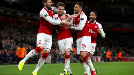 Arsenal's Mathieu Debuchy (centre) celebrates scoring his side's first goal of the game with team ma