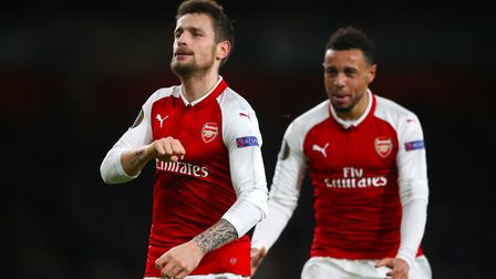 Arsenal's Mathieu Debuchy celebrates scoring his side's first goal of the game during the UEFA Europ