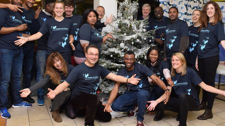 Staff, clients and supporters sing together in the choir at the Freedom From Torture Christmas Conce