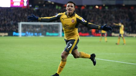 Arsenal's Alexis Sanchez celebrates scoring his side's second goal of the game during the Premier Le