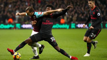 West Ham United's Mark Noble (left) and Arsenal's Ainsley Maitland-Niles battle for the ball as Gran