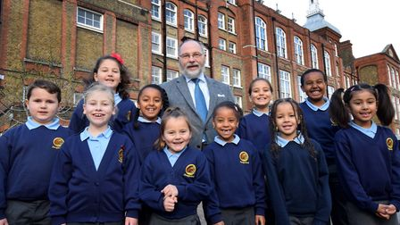 Retiring headteacher Brian Bench with children at Hungerford Primary School. Picture: Polly Hancock