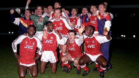 Arsenal celebrate winning the League Championship after their 3-1 win over Manchester United, two ye