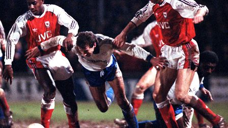 Shrewsbury's Kenny Clements is tackled by Arsenal's Micheal Thomas and David O'Leary. PA
