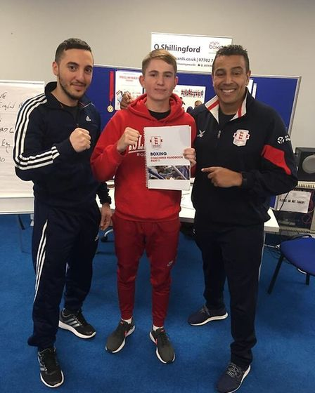 Islington's Connor Daly (centre) with assessors Bobby Miltiadous and Quinton Shillingford after pass