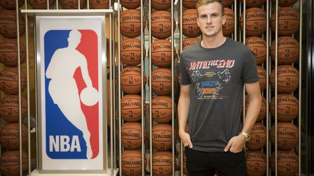 Arsenal's Rob Holding poses by the NBA logo
