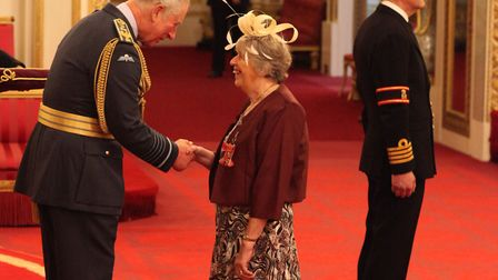 Chris Meadows is awarded the MBE by Prince Charles at Buckingham Palace. Picture: Yui Mok/PA Wire