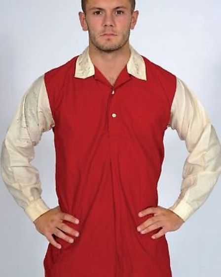 Jack Wilshere wearing the great Alex James' first-ever worn kit from 1933 which was lent to the club