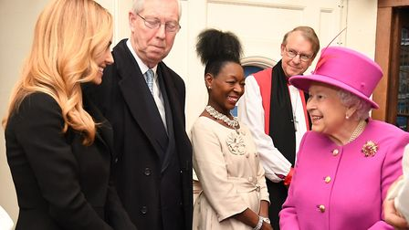 The Queen talks to Katherine Jenkins, as Foella Benjamin looks on, at the Scripture Union's 150th an