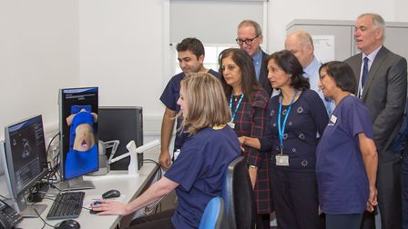Anne Marie–Scott, trainee sonographer showing senior staff and manager how it works at the Ultrasoun