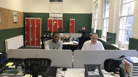 Staff at the South Kilburn Trust in their new premises in Carlton Vale