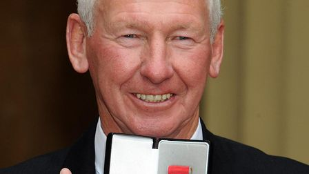 Former Arsenal goalkeeper Bob Wilson after receiving his OBE from Queen Elizabeth II during an Inves