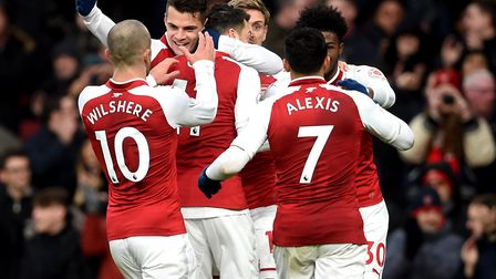 Arsenal's Mesut Ozil (centre) celebrates with team-mates after scoring his team's first goal during