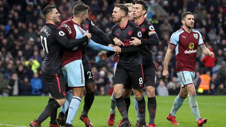 Burnley's Matthew Lowton and Arsenal's Aaron Ramsey have a heated discussion during the Premier Leag