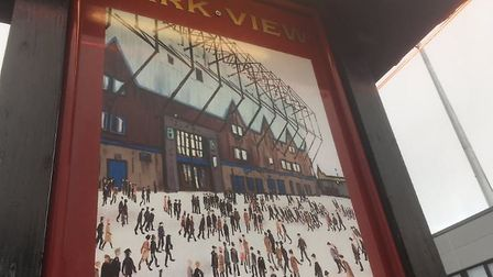 The Burnley take on LS Lowry's magical painting Going to the match at the pub the Park View next to