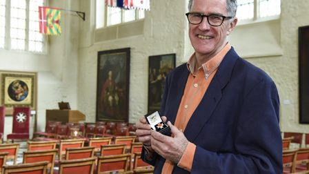 Andrew Thomas, husband of Leslie Forbes, with her organ donation award at Clerkenwell�s Priory Churc