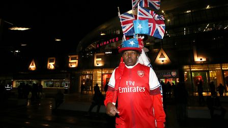 An Arsenal fan outside the Emirates Stadium during the Premier League match at the Emirates Stadium,