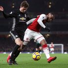 Manchester United's Victor Lindelof (left) and Arsenal's Alexandre Lacazette battle for the ball dur