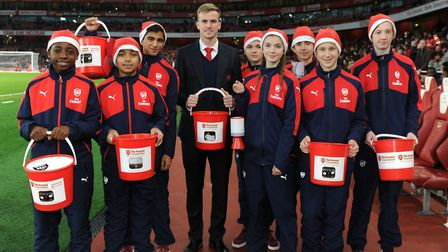 Arsenal defender Rob Holding helps with the collection boxes at last year's charity matchday, a game