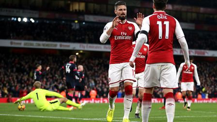 Arsenal's Olivier Giroud celebrates scoring his side's second goal against Huddersfield with Mesut O
