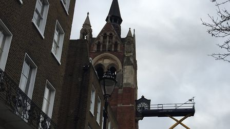 A worker fixes the Union Chapel clock in Upper Street. Picture: Annemarie Norton