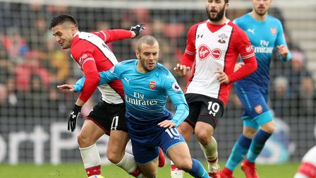 Southampton's Dusan Tadic (left) and Arsenal's Jack Wilshere battle for the ball at St Mary's Stadiu