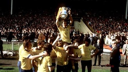 Arsenal celebrate victory over Liverpool in the 1971 FA Cup final. Peter Robinson/EMPICS