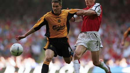 Michael Owen goes past Lee Dixon of Arsenal on his way to scoring his matchwinner in the 2001 FA Cup