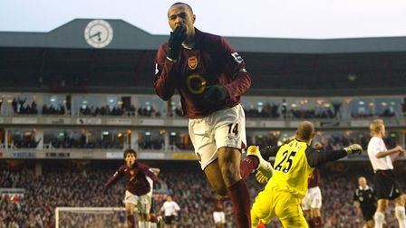Arsenal's Thierry Henry celebrates scoring the second goal after a mistake from Liverpool's Steven