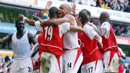 Arsenal's Thierry Henry (centre) celebrates with team-mates after the Barclaycard Premiership game a