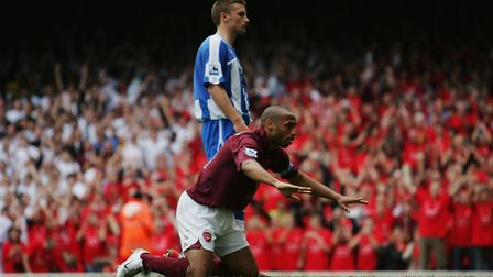 Thierry Henry of Arsenal celebrates by bowing to the North Bank fans during the last match at Highb