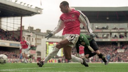 Thierry Henry completes his hat-trick for Arsenal as they thumped Leicester 6-1 on a goal crazy day