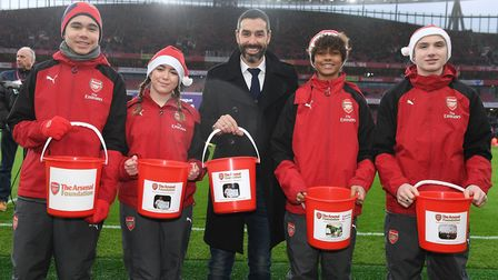 The Arsenal Ball Squad helped raise a separate �1,000 for an Islington charity project, and also hel