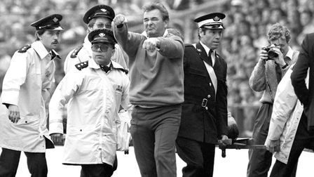 The original caption to this photo reads: Brian Clough showing contempt for the fans of Nottingham F