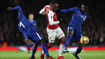 Chelsea's N'Golo Kante and Tiemoue Bakayoko (right) challenge Arsenal's Alexandre Lacazette during t