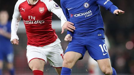Arsenal's Jack Wilshere and Chelsea's Eden Hazard (right) battle for the ball during the Premier Lea