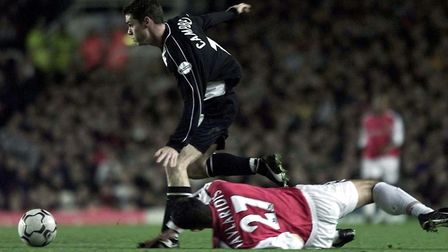 Arsenal's Stathis Tavlaridis (grounded) and Grimsby Town's Stuart Campbell during the Worthington Cu