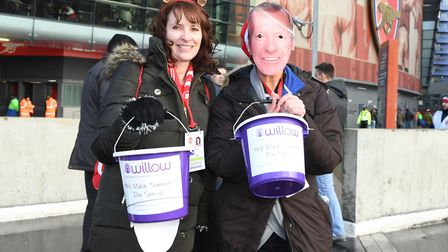 Volunteers collecting outside the Emirates during the Arsenal Foundation day. Arsenal FC via Getty I